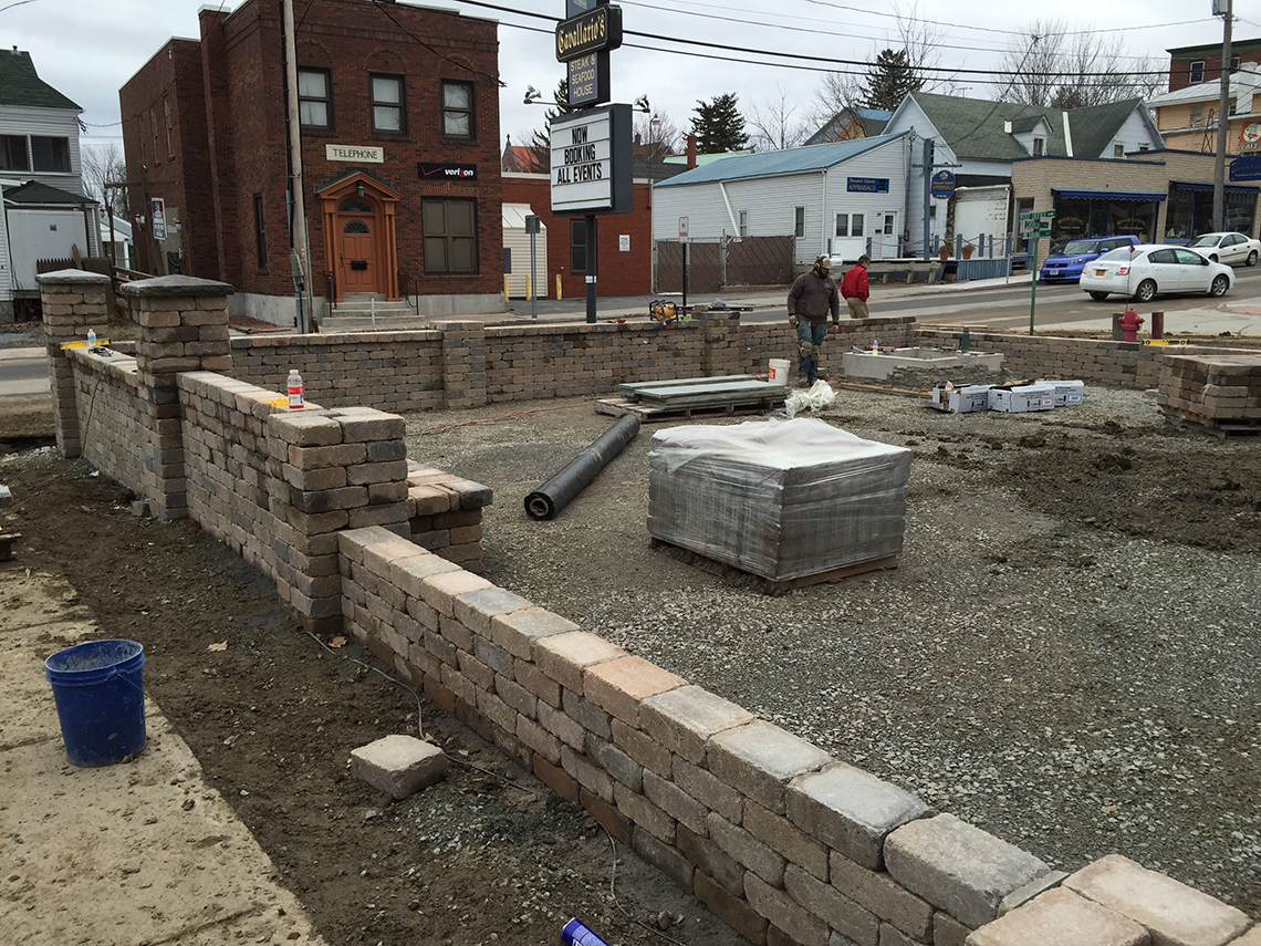 Walls Up, It's Time To Level Ground for the Pavers