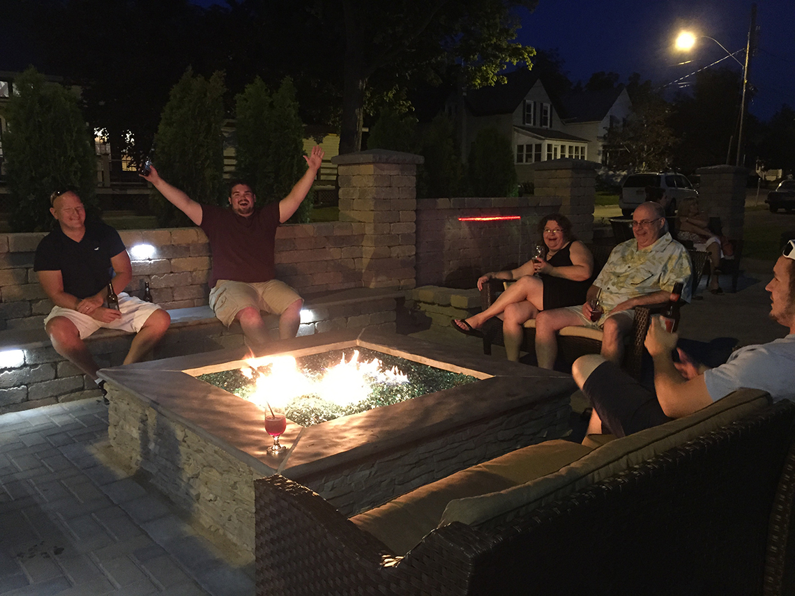 Diners Enjoying Drinks Around the Fire Feature